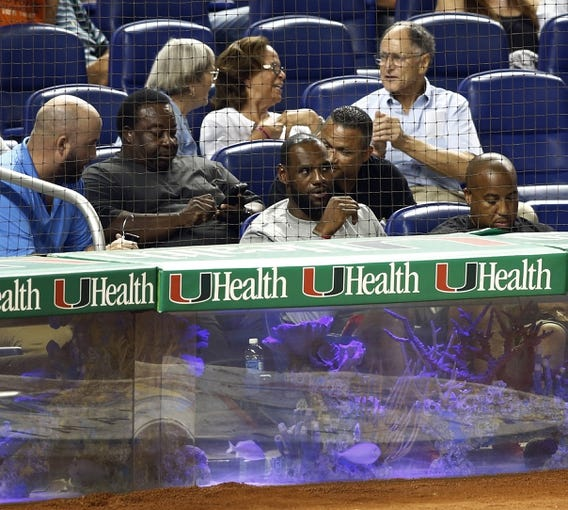 Aug 21, 2013; Miami, FL, USA;  Miami Heat forward LeBron James attends the game between the Los Angeles Dodgers and Miami Marlins at Marlins Park. Mandatory Credit: Robert Mayer-USA TODAY Sports