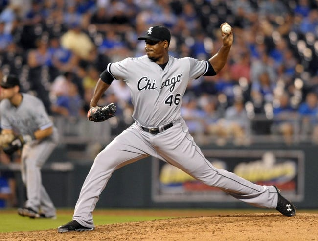 Aug 21, 2013; Kansas City, MO, USA; Chicago White Sox relief pitcher Donnie Veal (46) delivers a pitch in the seventh inning of the game against the Kansas City Royals at Kauffman Stadium. Chicago won 5-2. Mandatory Credit: Denny Medley-USA TODAY Sports