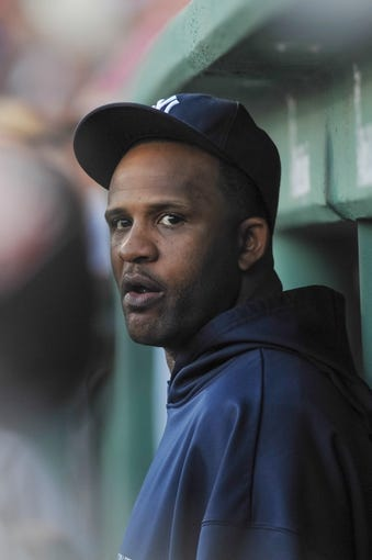 Aug 16, 2013; Boston, MA, USA; New York Yankees starting pitcher CC Sabathia (52) in the dugout during the first inning against the Boston Red Sox at Fenway Park. Mandatory Credit: Bob DeChiara-USA TODAY Sports