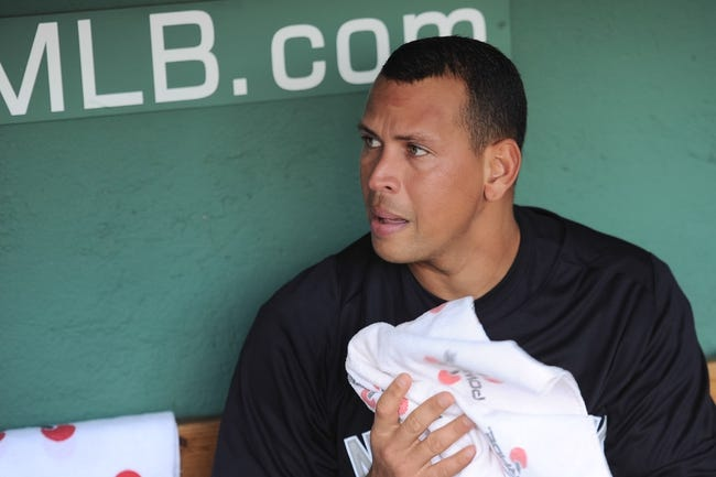 Aug 16, 2013; Boston, MA, USA; New York Yankees third baseman Alex Rodriguez (13) in the dugout prior to a game against the Boston Red Sox at Fenway Park. Mandatory Credit: Bob DeChiara-USA TODAY Sports