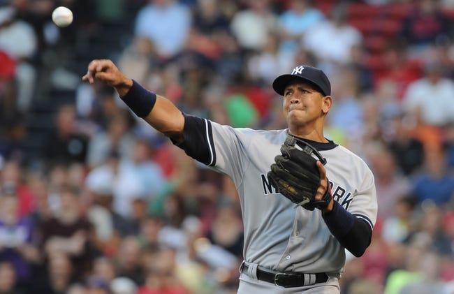 Aug 16, 2013; Boston, MA, USA; New York Yankees third baseman Alex Rodriguez (13) warms up before a game against the Boston Red Sox at Fenway Park. Mandatory Credit: Bob DeChiara-USA TODAY Sports