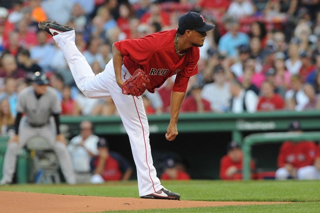 Aug 16, 2013; Boston, MA, USA; Boston Red Sox starting pitcher Felix Doubront (22) pitches during the first inning against the New York Yankees at Fenway Park. Mandatory Credit: Bob DeChiara-USA TODAY Sports
