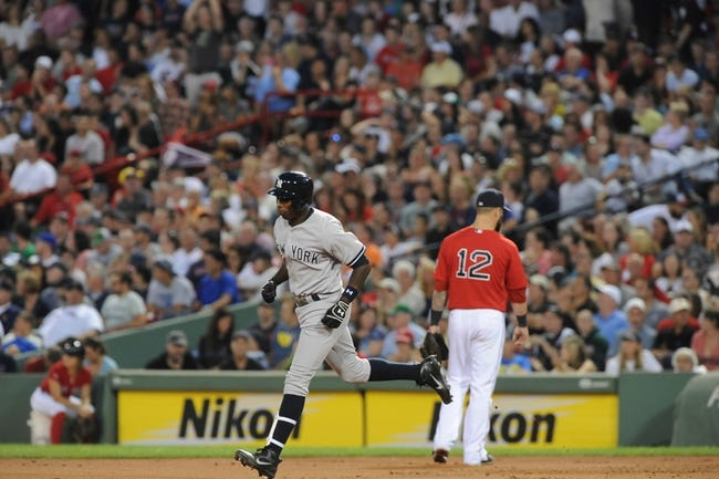 Aug 16, 2013; Boston, MA, USA; New York Yankees left fielder Alfonso Soriano (12) rounds the bases after hitting a home run during the third inning against the Boston Red Sox at Fenway Park. Mandatory Credit: Bob DeChiara-USA TODAY Sports