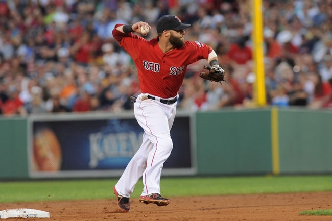 Aug 16, 2013; Boston, MA, USA; Boston Red Sox second baseman Dustin Pedroia (15) makes a throw to first base during the second inning against the New York Yankees at Fenway Park. Mandatory Credit: Bob DeChiara-USA TODAY Sports