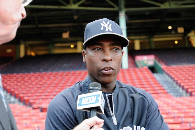Aug 16, 2013; Boston, MA, USA; New York Yankees left fielder Alfonso Soriano (12) talks to a reporter prior to a game against the Boston Red Sox at Fenway Park. Mandatory Credit: Bob DeChiara-USA TODAY Sports
