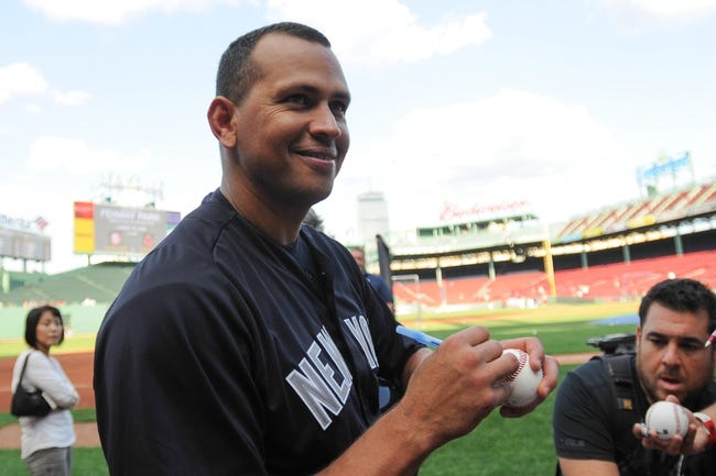 Aug 16, 2013; Boston, MA, USA; New York Yankees third baseman Alex Rodriguez (13) signs an autograph prior to a game against the Boston Red Sox at Fenway Park. Mandatory Credit: Bob DeChiara-USA TODAY Sports