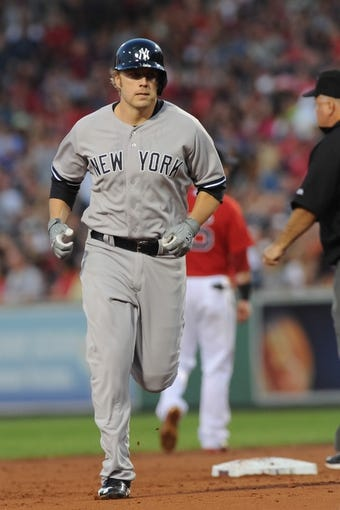 Aug 16, 2013; Boston, MA, USA; New York Yankees first baseman Mark Reynolds (39) rounds the bases after hitting a home run during the second inning against the Boston Red Sox at Fenway Park. Mandatory Credit: Bob DeChiara-USA TODAY Sports