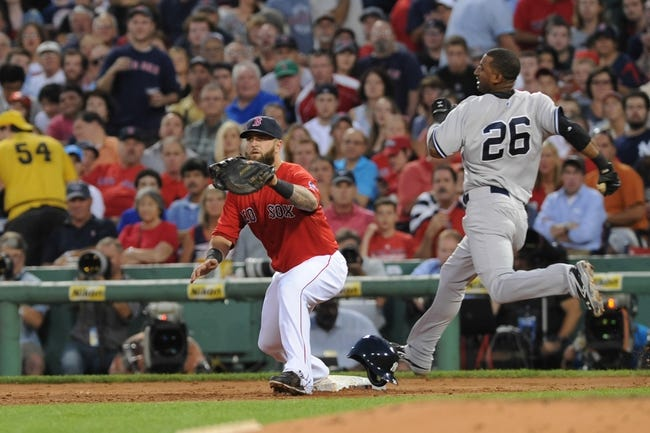 Aug 16, 2013; Boston, MA, USA; New York Yankees shortstop Eduardo Nunez (26) beats out an infield hit for a single during the third inning against the Boston Red Sox at Fenway Park. Mandatory Credit: Bob DeChiara-USA TODAY Sports