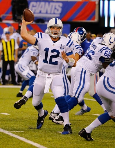 Aug 18, 2013; East Rutherford, NJ, USA; Indianapolis Colts quarterback Andrew Luck (12) throws a pass during the first half against the New York Giants at MetLife Stadium. Mandatory Credit: Jim O'Connor-USA TODAY Sports