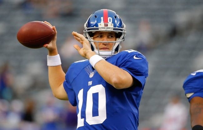 Aug 18, 2013; East Rutherford, NJ, USA; New York Giants quarterback Eli Manning (10) prior to game against the Indianapolis Colts at MetLife Stadium. Mandatory Credit: Jim O'Connor-USA TODAY Sports