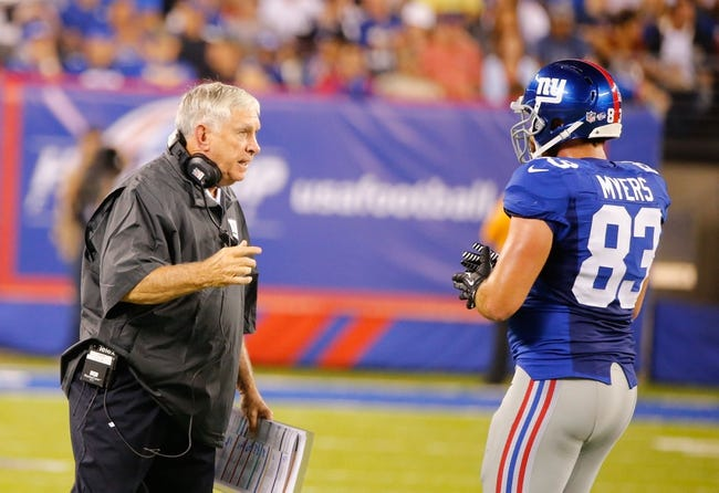 Aug 18, 2013; East Rutherford, NJ, USA; New York Giants tight end coach Michael Pope gives instructions to tight end Brandon Myers (83) during the first half against the Indianapolis Colts at MetLife Stadium. Mandatory Credit: Jim O'Connor-USA TODAY Sports