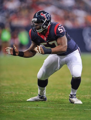 Aug 17, 2013; Houston, TX, USA; Houston Texans linebacker Sam Montgomery (57) during the game between the Texans and the Miami Dolphins at Reliant Stadium. The Texans defeated the Dolphins 24-17. Mandatory Credit: Jerome Miron-USA TODAY Sports