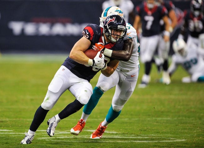 Aug 17, 2013; Houston, TX, USA; Houston Texans tight end Garrett Graham (88) is tackled by Miami Dolphins linebacker Josh Kaddu (57) during the game at Reliant Stadium. The Texans defeated the Dolphins 24-17. Mandatory Credit: Jerome Miron-USA TODAY Sports