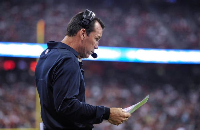 Aug 17, 2013; Houston, TX, USA; Houston Texans head coach Gary Kubiak calls a play during the game between the Texans and the Miami Dolphins at Reliant Stadium. The Texans defeated the Dolphins 24-17. Mandatory Credit: Jerome Miron-USA TODAY Sports