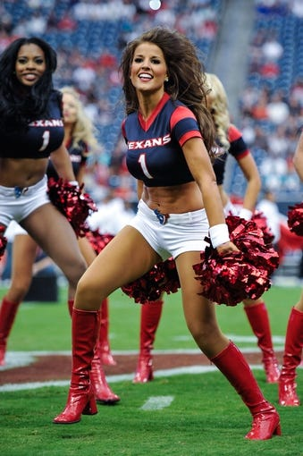 Aug 17, 2013; Houston, TX, USA; A Houston Texans cheerleader performs during the game between the Texans and the Miami Dolphins at Reliant Stadium. The Texans defeated the Dolphins 24-17. Mandatory Credit: Jerome Miron-USA TODAY Sports