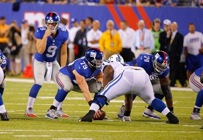 Aug 18, 2013; East Rutherford, NJ, USA; New York Giants quarterback Ryan Nassib (9) over guard Stephen Goodin (79) at MetLife Stadium. Indianapolis Colts defeat the New York Giants 20-12. Mandatory Credit: Jim O'Connor-USA TODAY Sports