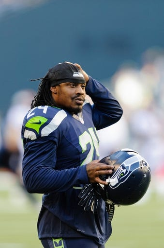 Aug 17, 2013; Seattle, WA, USA; Seattle Seahawks running back Marshawn Lynch (24) during team warm ups prior to the game against the Denver Broncos at CenturyLink Field. Seattle defeated Denver 40-10. Mandatory Credit: Steven Bisig-USA TODAY Sports