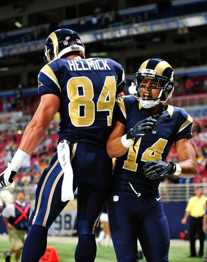 Aug 17, 2013; St. Louis, MO, USA; St. Louis Rams wide receiver Nick Johnson (14) is congratulated after catching a touchdown pass against the Green Bay Packers during the second half at the Edward Jones Dome. Mandatory Credit: Scott Rovak-USA TODAY Sports