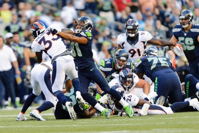 Aug 17, 2013; Seattle, WA, USA; Seattle Seahawks wide receiver Golden Tate (81) blocks Denver Broncos safety Duke Ihenacho (33) during the 1st half at CenturyLink Field. Seattle defeated Denver 40-10. Mandatory Credit: Steven Bisig-USA TODAY Sports