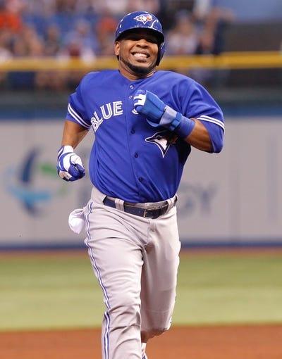 Aug 16, 2013; St. Petersburg, FL, USA; Toronto Blue Jays first baseman Edwin Encarnacion (10) runs to third base against the Tampa Bay Rays at Tropicana Field. Mandatory Credit: Kim Klement-USA TODAY Sports