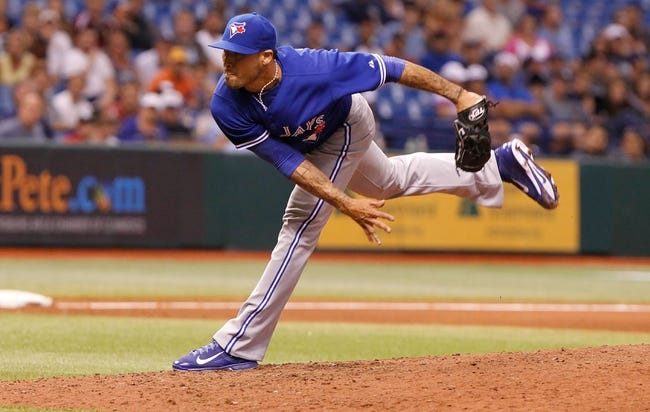 Aug 16, 2013; St. Petersburg, FL, USA; Toronto Blue Jays relief pitcher Sergio Santos (21) throws a pitch against the Tampa Bay Rays at Tropicana Field. Tampa Bay Rays defeated the Toronto Blue Jays 5-4. Mandatory Credit: Kim Klement-USA TODAY Sports