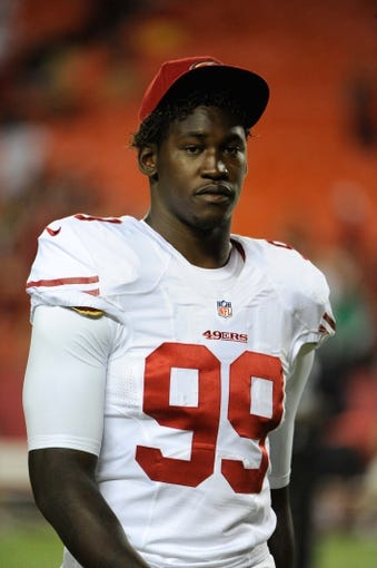 Aug 16, 2013; Kansas City, MO, USA; San Francisco 49ers linebacker Aldon Smith (99) leaves the field after the game against the Kansas City Chiefs at Arrowhead Stadium. San Francisco won the game 15-13. Mandatory Credit: John Rieger-USA TODAY Sports