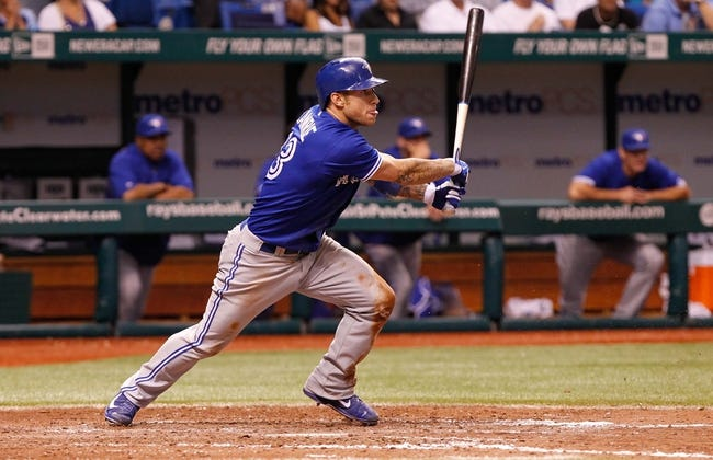 Aug 16, 2013; St. Petersburg, FL, USA; Toronto Blue Jays third baseman Brett Lawrie (13) at bat against the Tampa Bay Rays at Tropicana Field. Tampa Bay Rays defeated the Toronto Blue Jays 5-4. Mandatory Credit: Kim Klement-USA TODAY Sports