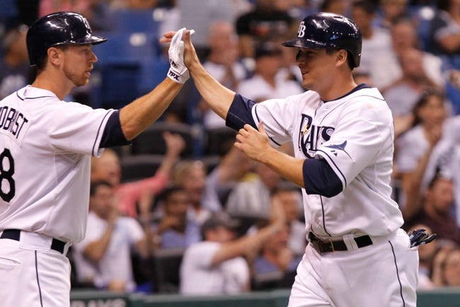 Aug 16, 2013; St. Petersburg, FL, USA; Tampa Bay Rays left fielder Kelly Johnson (2) high fives second baseman Ben Zobrist (18) after he scored a run against the Toronto Blue Jays at Tropicana Field. Tampa Bay Rays defeated the Toronto Blue Jays 5-4. Mandatory Credit: Kim Klement-USA TODAY Sports