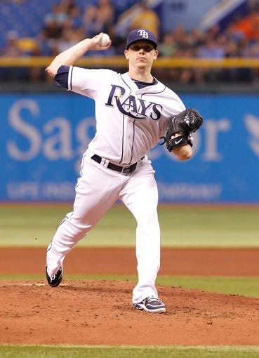Aug 16, 2013; St. Petersburg, FL, USA; Tampa Bay Rays starting pitcher Jeremy Hellickson (58) throws a pitch against the Toronto Blue Jays at Tropicana Field. Mandatory Credit: Kim Klement-USA TODAY Sports