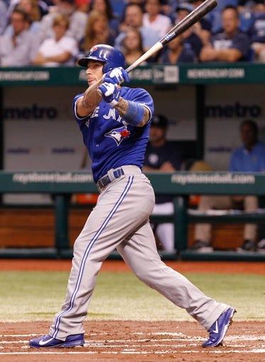Aug 16, 2013; St. Petersburg, FL, USA; Toronto Blue Jays third baseman Brett Lawrie (13) at bat against the Tampa Bay Rays at Tropicana Field. Mandatory Credit: Kim Klement-USA TODAY Sports