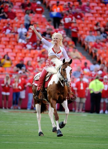 Aug 16, 2013; Kansas City, MO, USA; A Kansas City Chiefs cheerleaders rides onto the field before the game against the San Francisco 49ers at Arrowhead Stadium. San Francisco won the game 15-13. Mandatory Credit: John Rieger-USA TODAY Sports