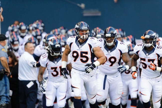 Aug 17, 2013; Seattle, WA, USA; Denver Broncos defensive end Derek Wolfe (95) leads the Broncos out of the tunnel during the opening ceremonies prior to the game against the Seattle Seahawks at CenturyLink Field. Seattle defeated Denver 40-10. Mandatory Credit: Steven Bisig-USA TODAY Sports