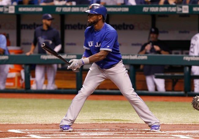 Aug 16, 2013; St. Petersburg, FL, USA; Toronto Blue Jays shortstop Jose Reyes (7) at bat against the Tampa Bay Rays at Tropicana Field. Mandatory Credit: Kim Klement-USA TODAY Sports