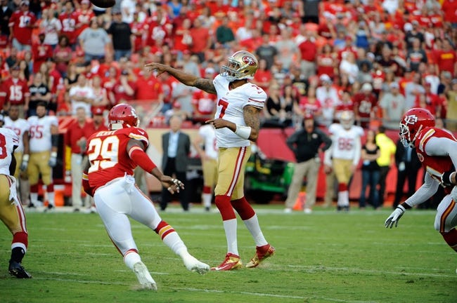 Aug 16, 2013; Kansas City, MO, USA; San Francisco 49ers quarterback Colin Kaepernick (7) throws a pass against the Kansas City Chiefs in the first half at Arrowhead Stadium. Mandatory Credit: John Rieger-USA TODAY Sports