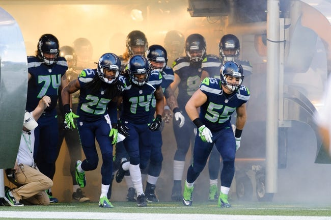 Aug 17, 2013; Seattle, WA, USA; Seattle Seahawks linebacker Heath Farwell (55) leads the team out of the tunnel during the open ceremonies prior to the game against the Denver Broncos at CenturyLink Field. Seattle defeated Denver 40-10. Mandatory Credit: Steven Bisig-USA TODAY Sports