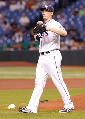 Aug 16, 2013; St. Petersburg, FL, USA; Tampa Bay Rays starting pitcher Jeremy Hellickson (58) reacts on the mound against the Toronto Blue Jays at Tropicana Field. Mandatory Credit: Kim Klement-USA TODAY Sports
