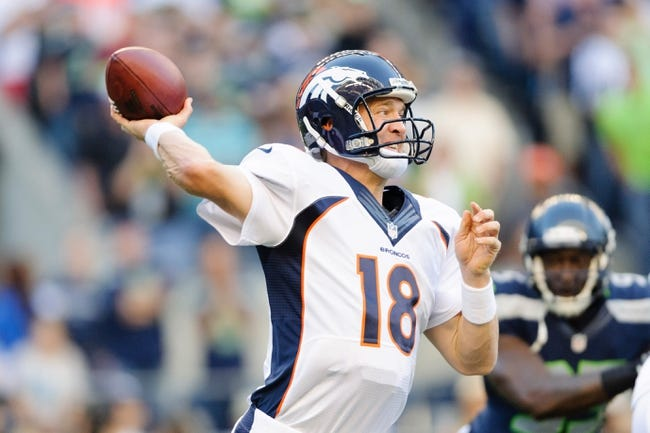 Aug 17, 2013; Seattle, WA, USA; Denver Broncos quarterback Peyton Manning (18) passes the ball during the 1st half against the Seattle Seahawks at CenturyLink Field. Seattle defeated Denver 40-10. Mandatory Credit: Steven Bisig-USA TODAY Sports