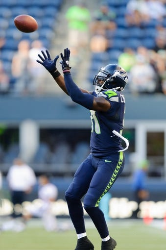 Aug 17, 2013; Seattle, WA, USA; Seattle Seahawks strong safety Kam Chancellor (31) catches a pass during team warm ups prior to the game against the Denver Broncos at CenturyLink Field. Seattle defeated Denver 40-10. Mandatory Credit: Steven Bisig-USA TODAY Sports