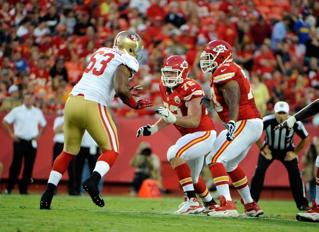 Aug 16, 2013; Kansas City, MO, USA; Kansas City Chiefs tackle Eric Fisher (72) and guard Jon Asamoah (73) block against San Francisco 49ers defensive tackle Tony Jerod-Eddie (63) in the first half at Arrowhead Stadium. San Francisco won the game 15-13. Mandatory Credit: John Rieger-USA TODAY Sports