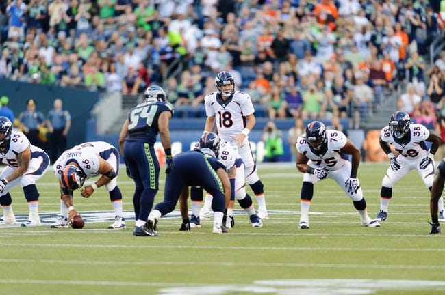 Aug 17, 2013; Seattle, WA, USA; Denver Broncos quarterback Peyton Manning (18) calls out a play at the line during the 1st half against the Seattle Seahawks at CenturyLink Field. Seattle defeated Denver 40-10. Mandatory Credit: Steven Bisig-USA TODAY Sports