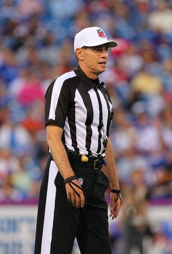 Aug 16, 2013; Orchard Park, NY, USA;  NFL referee Tony Corrente (99) during a game between the Buffalo Bills and the Minnesota Vikings at Ralph Wilson Stadium.  Mandatory Credit: Timothy T. Ludwig-USA TODAY Sports