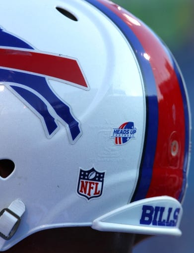 Aug 16, 2013; Orchard Park, NY, USA;  A view of the Heads Up Football logo on a Buffalo Bills players helmet before a game against the Minnesota Vikings at Ralph Wilson Stadium.  Mandatory Credit: Timothy T. Ludwig-USA TODAY Sports