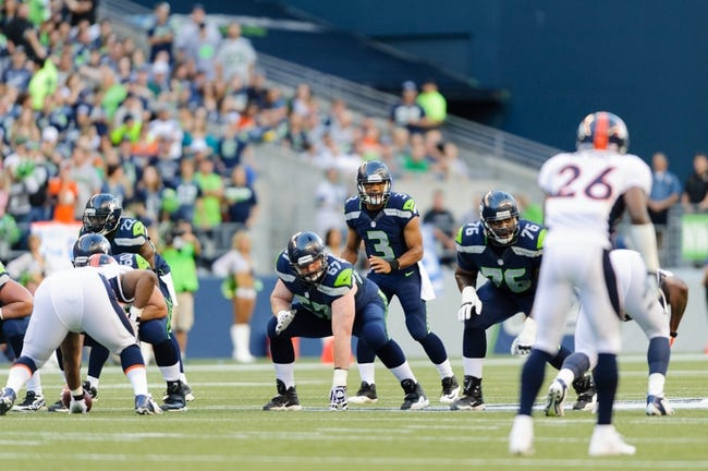 Aug 17, 2013; Seattle, WA, USA; Seattle Seahawks quarterback Russell Wilson (3) calls out a play at the line during the 1st half against the Denver Broncos at CenturyLink Field. Seattle defeated Denver 40-10. Mandatory Credit: Steven Bisig-USA TODAY Sports