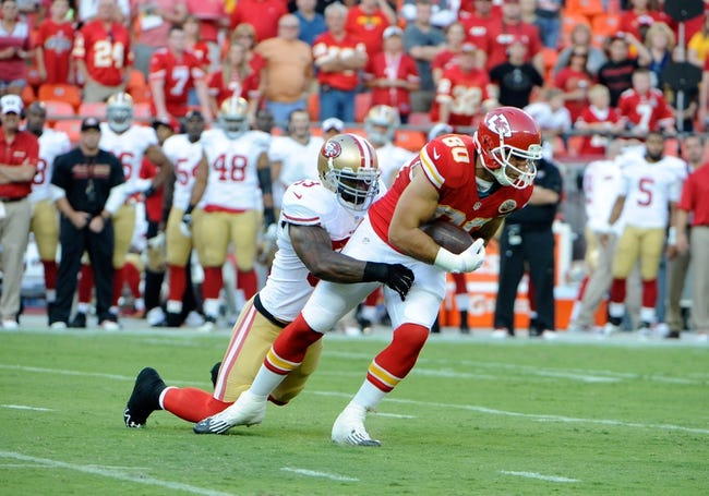 Aug 16, 2013; Kansas City, MO, USA; Kansas City Chiefs tightened Anthony Fasano (80) is tackled by San Francisco 49ers linebacker NaVorro Bowman (53) in the first half at Arrowhead Stadium. San Francisco won the game 15-13. Mandatory Credit: John Rieger-USA TODAY Sports