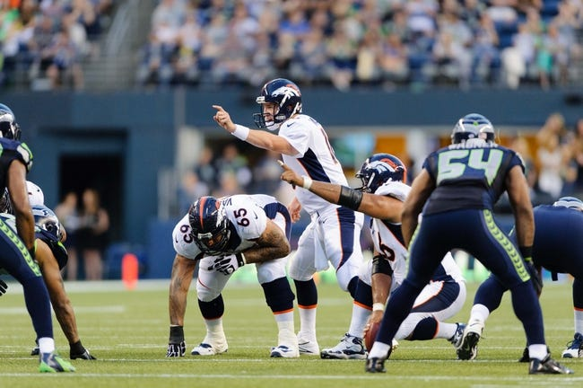 Aug 17, 2013; Seattle, WA, USA; Denver Broncos quarterback Peyton Manning (18) calls out an audible at the line during the 1st half against the Seattle Seahawks at CenturyLink Field. Seattle defeated Denver 40-10. Mandatory Credit: Steven Bisig-USA TODAY Sports