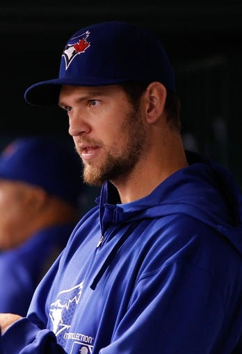 Aug 16, 2013; St. Petersburg, FL, USA; Toronto Blue Jays starting pitcher Josh Johnson (55) in the dugout against the Tampa Bay Rays at Tropicana Field. Mandatory Credit: Kim Klement-USA TODAY Sports