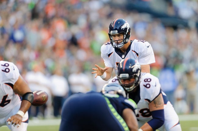 Aug 17, 2013; Seattle, WA, USA; Denver Broncos quarterback Peyton Manning (18) takes the shot gun snap during the 1st half against the Seattle Seahawks at CenturyLink Field. Seattle defeated Denver 40-10. Mandatory Credit: Steven Bisig-USA TODAY Sports