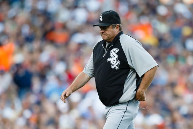 Aug 3, 2013; Detroit, MI, USA; Chicago White Sox pitching coach Don Cooper (99) walks off the field against the Detroit Tigers at Comerica Park. Mandatory Credit: Rick Osentoski-USA TODAY Sports