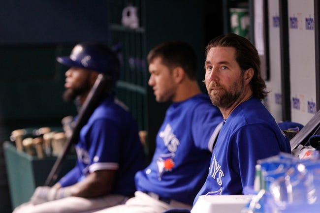 Aug 16, 2013; St. Petersburg, FL, USA; Toronto Blue Jays starting pitcher R.A. Dickey (43) in the dugout between pitching against the Tampa Bay Rays at Tropicana Field. Mandatory Credit: Kim Klement-USA TODAY Sports