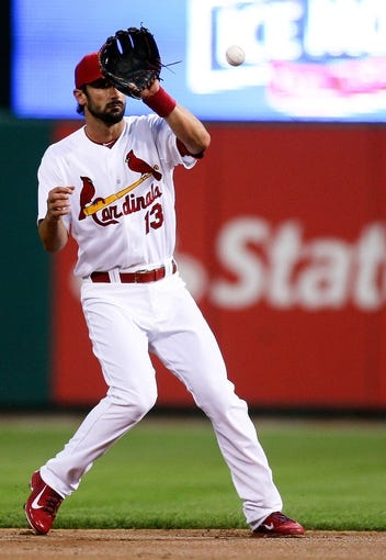 Aug 22, 2013; St. Louis, MO, USA; St. Louis Cardinals second baseman Matt Carpenter (13) fields the ball for an out in the second inning against the Atlanta Braves at Busch Stadium. Mandatory Credit: Scott Kane-USA TODAY Sports